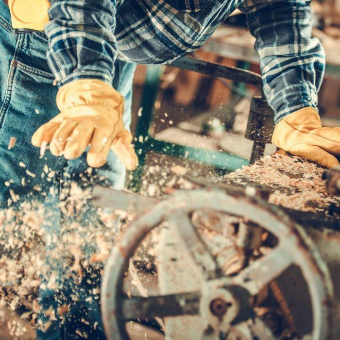 Wood Planks Planning Job. Caucasian Woodworking Machine Operator.