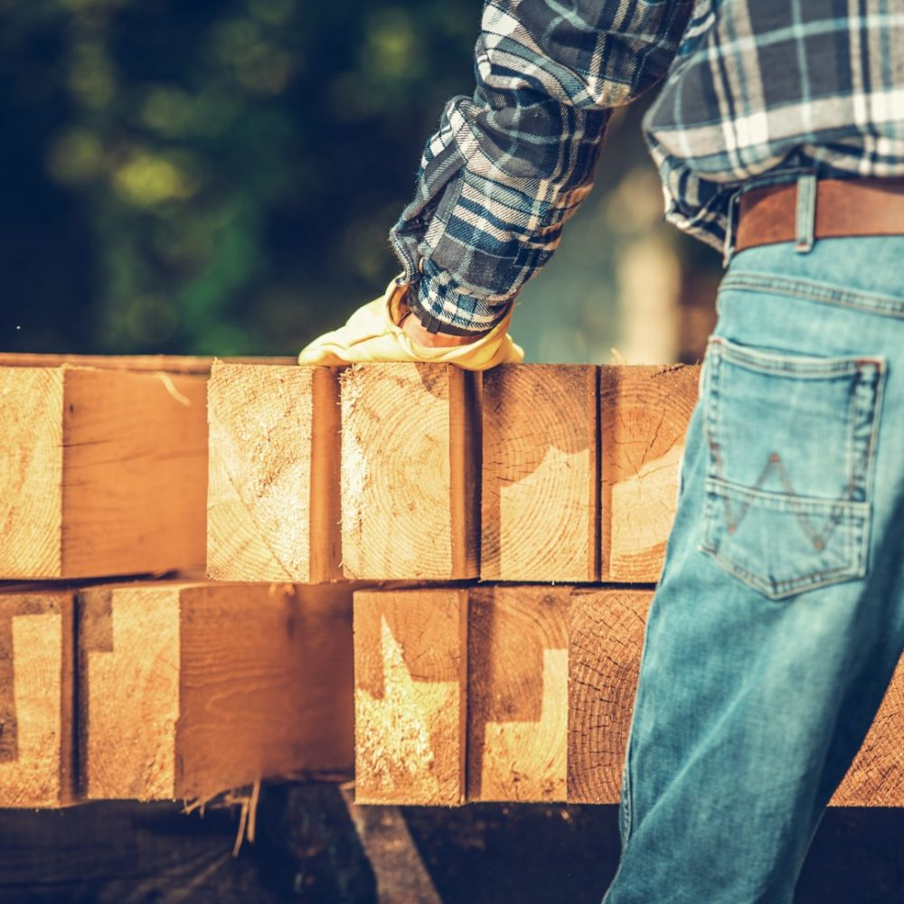 Carpenter Wood Material. Woodworking Contractor Preparing for the Construction Job.